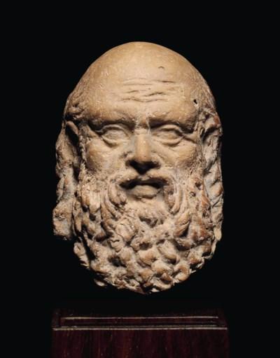 A GREEK TERRACOTTA HEAD OF A M