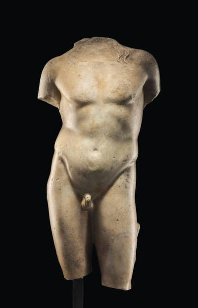 A ROMAN MARBLE TORSO OF DIONYS