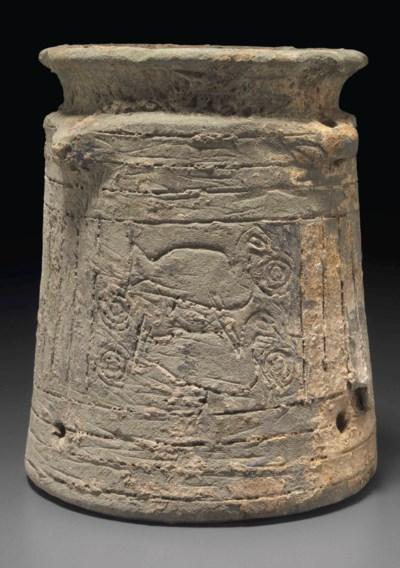AN OLD BABYLONIAN POTTERY JAR