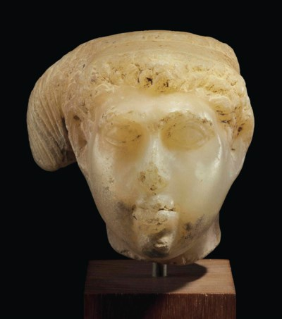 AN EGYPTIAN ALABASTER HEAD OF