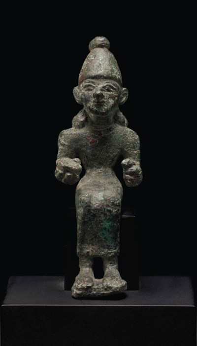 A SYRO-CANAANITE BRONZE SEATED