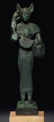 AN EGYPTIAN BRONZE BASTET