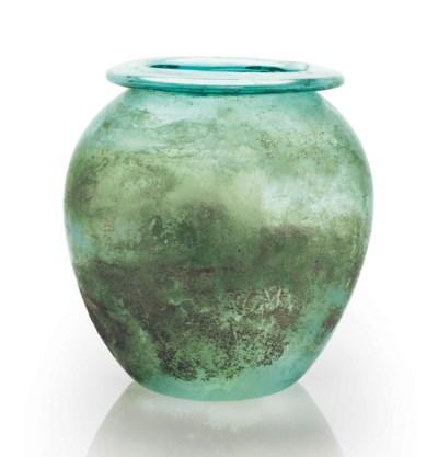 A ROMAN GLASS CINERARY URN