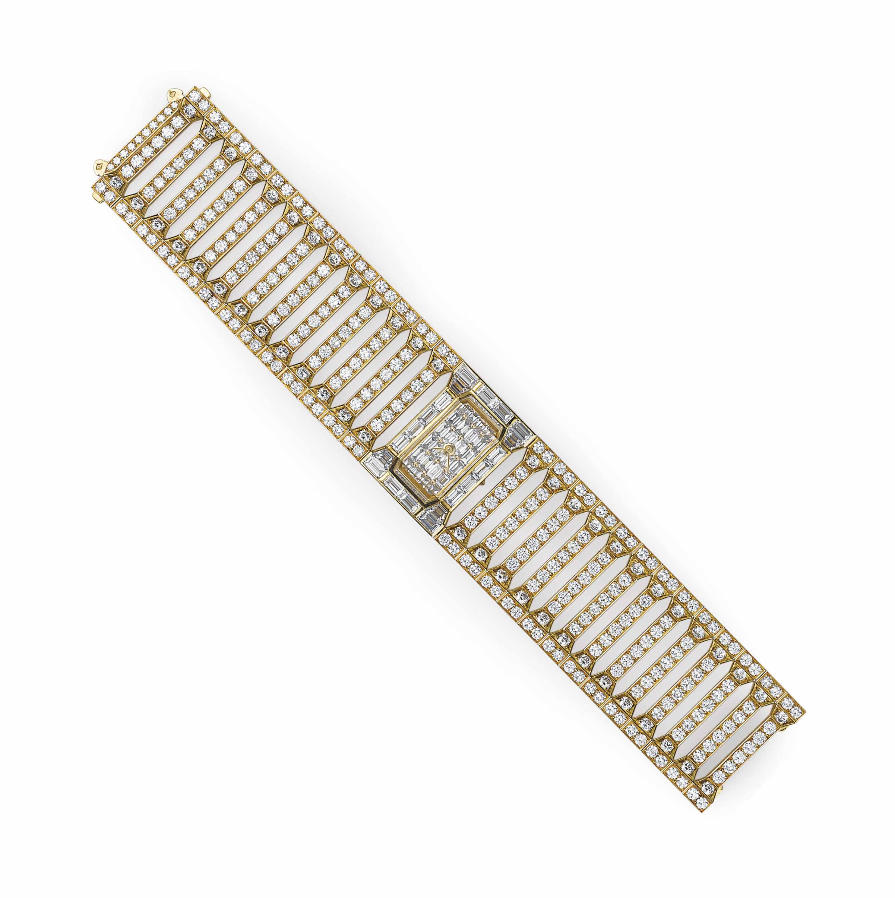 A DIAMOND AND GOLD BRACELET WR