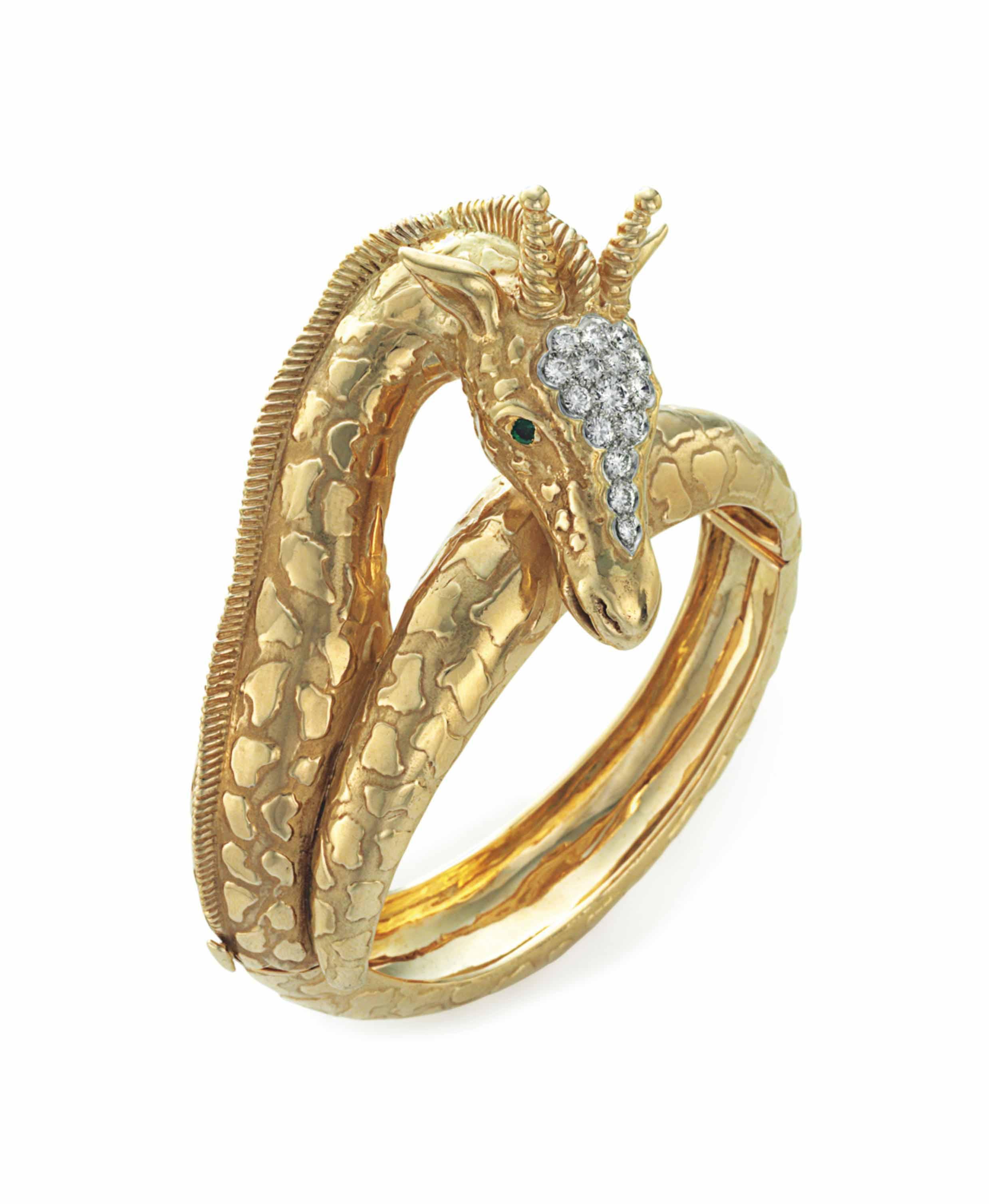 A DIAMOND, EMERALD AND GOLD GI