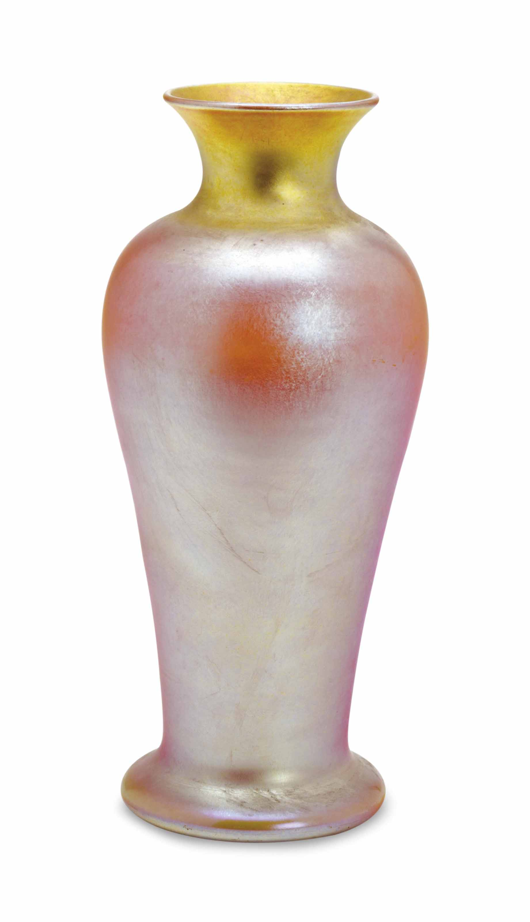 AN AMERICAN IRIDESCENT YELLOW GLASS VASE,