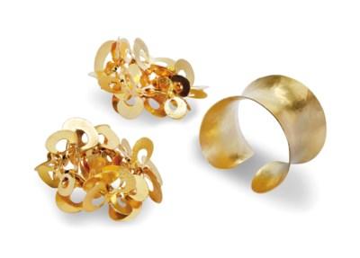 THREE GOLD-PLATE HAMMERED BRAS