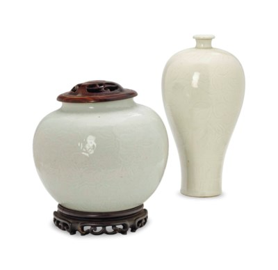 A CHINESE CARVED WHITE-GLAZED