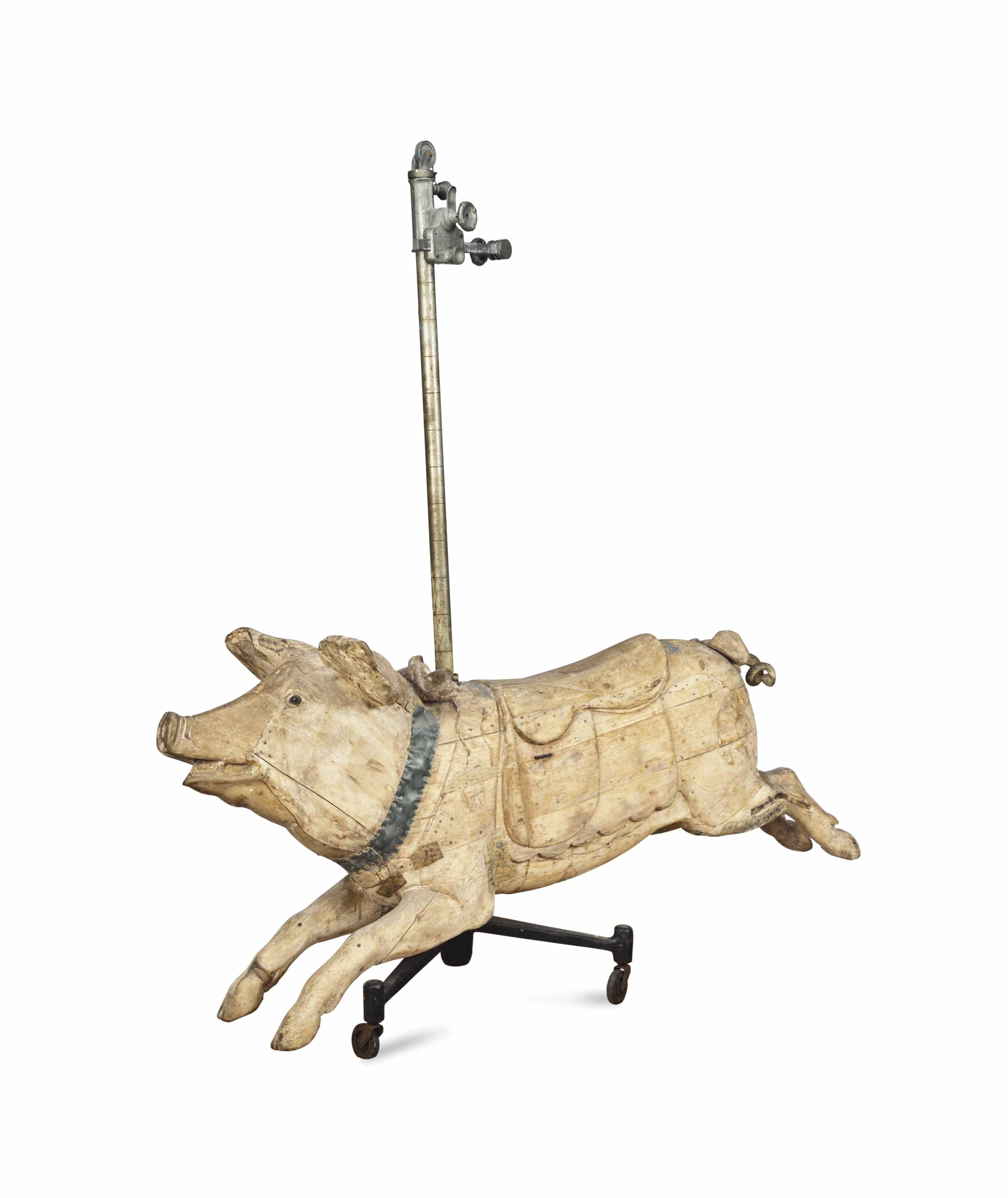 A FRENCH CARVED OAK CAROUSEL A