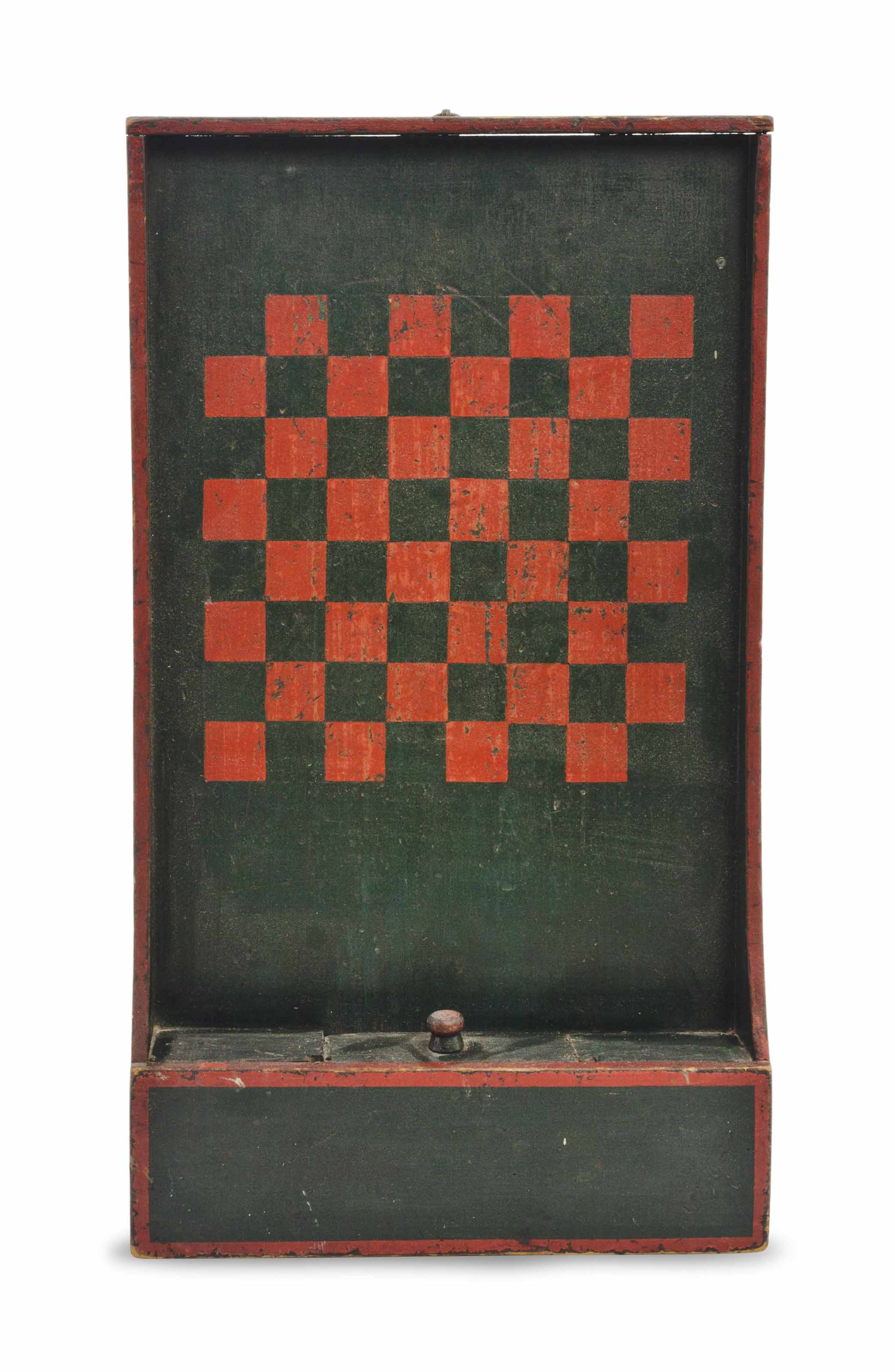 A RED AND GREEN-PAINTED GAMEBO