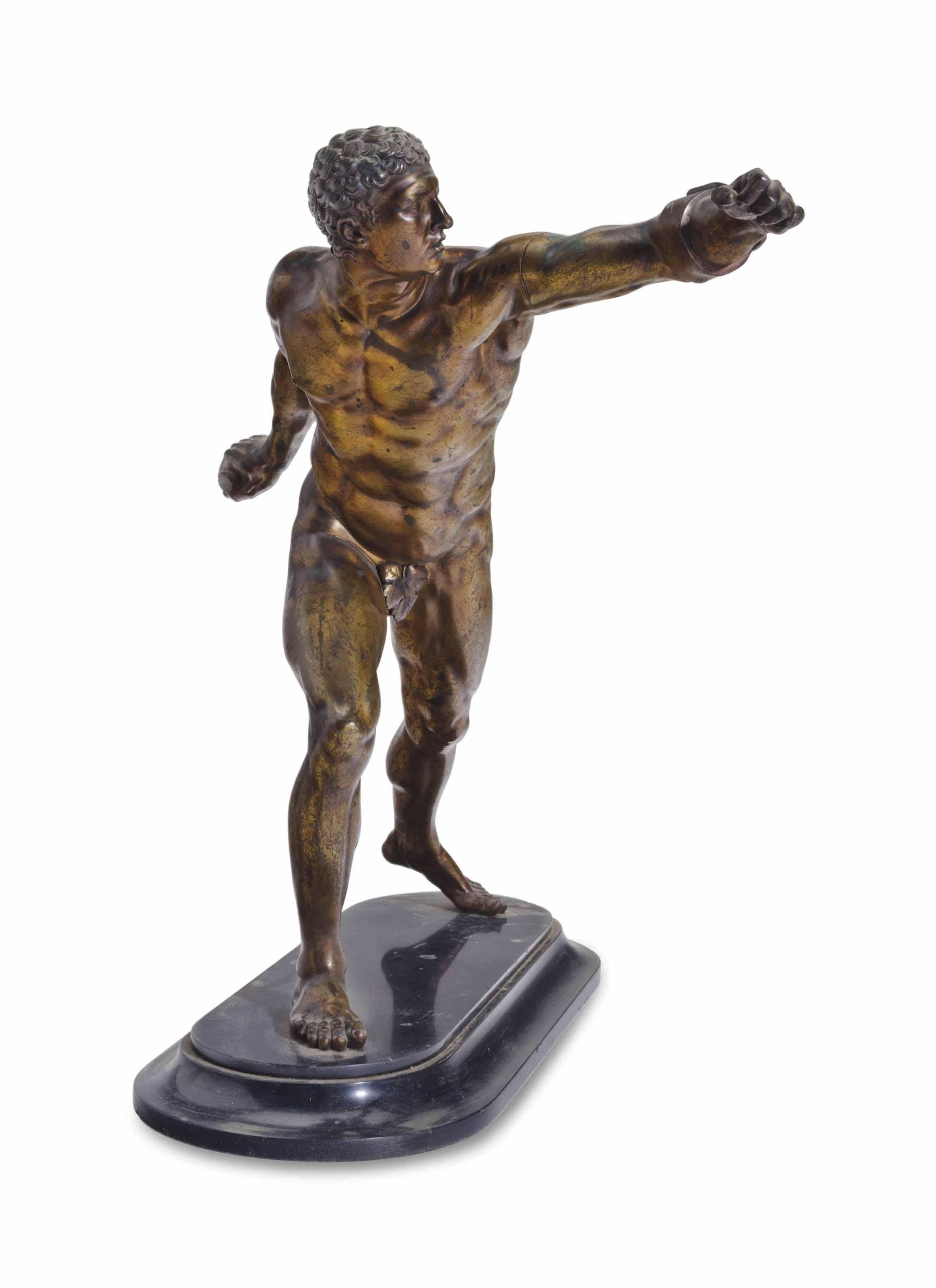 A PATINATED METAL FIGURE OF TH