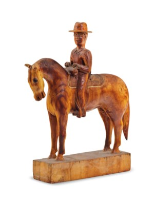 AN AMERICAN CARVED MODEL OF A