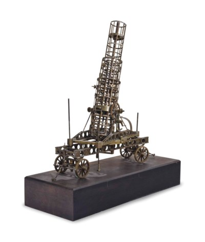 A BRASS MODEL OF AN OIL DERRIC