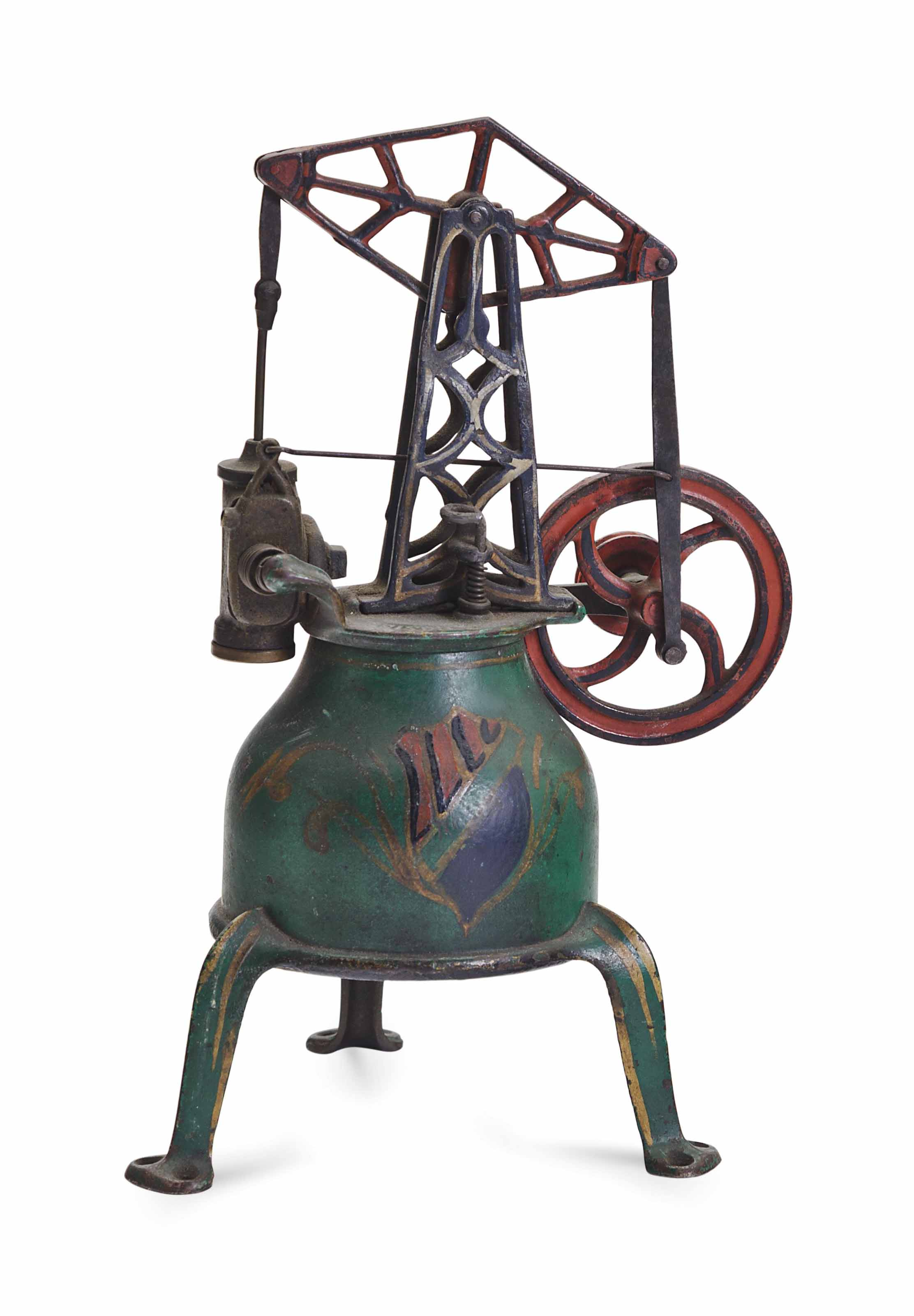 A PAINTED CAST IRON MODEL OF A