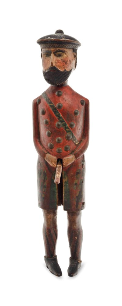A POLYCHROME-PAINTED FIGURE OF