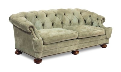A GREEN SUEDE BUTTON-TUFTED SO