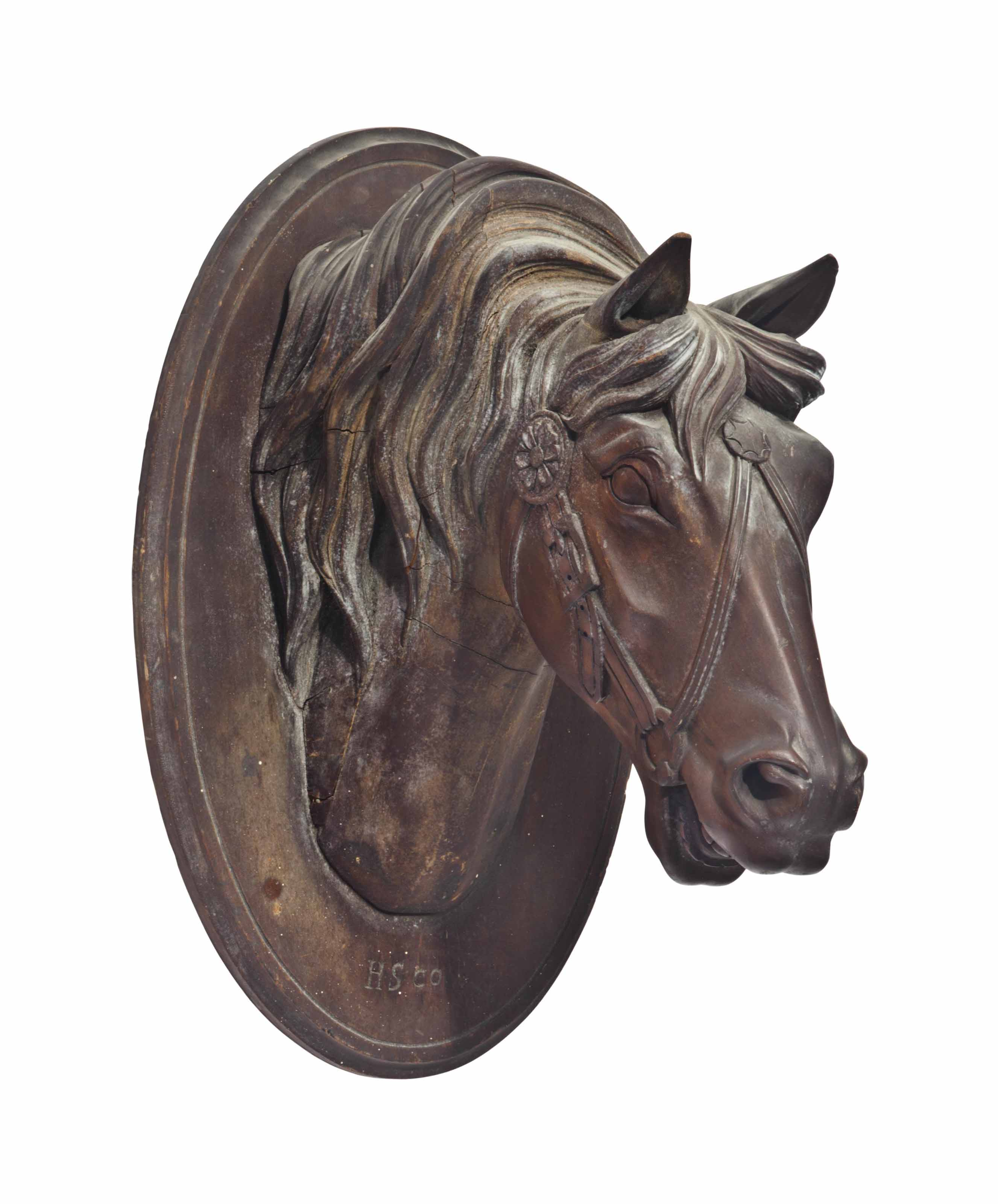 A STAINED WOOD HORSE HEAD-FORM