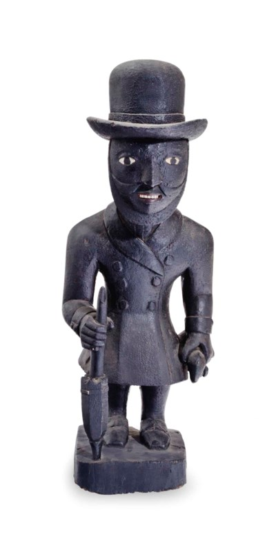 A BLACK-PAINTED FIGURE OF A ST