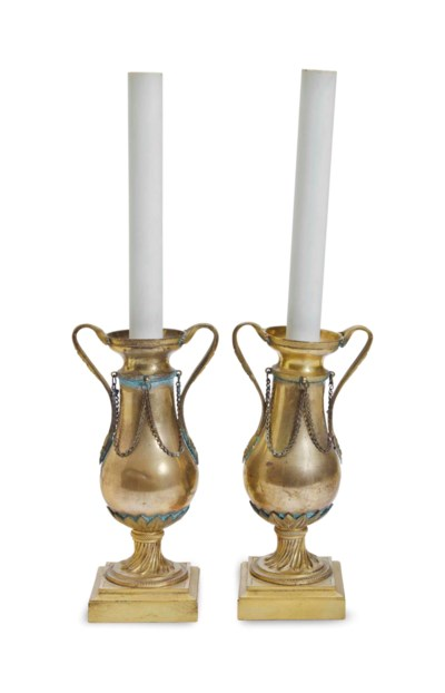 A PAIR OF GILT METAL URNS NOW