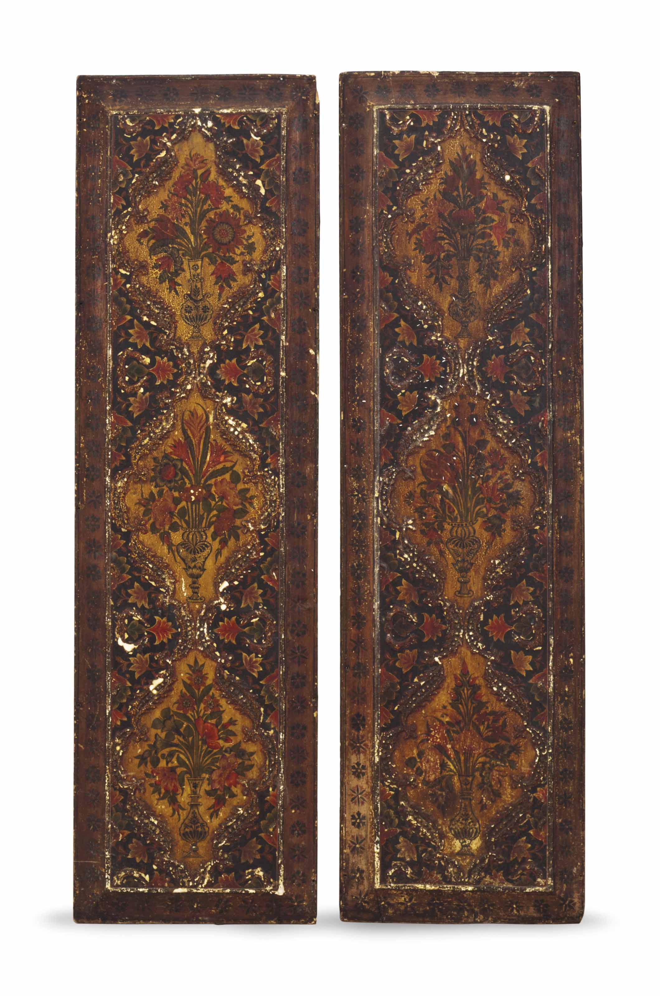 A PAIR OF CARVED AND POLYCHROM