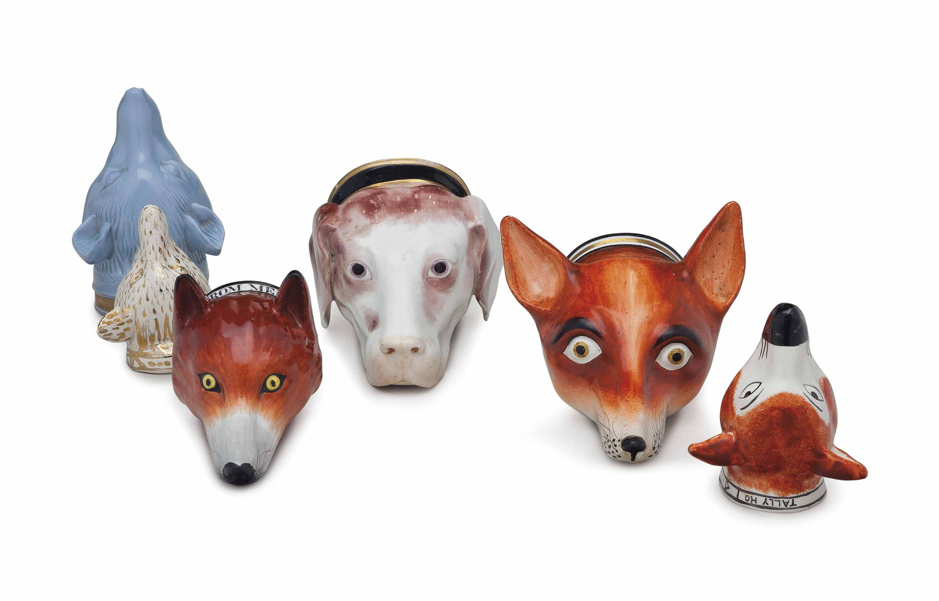 SIX ENGLISH PORCELAIN FOX AND HOUND FORM STIRRUP CUPS