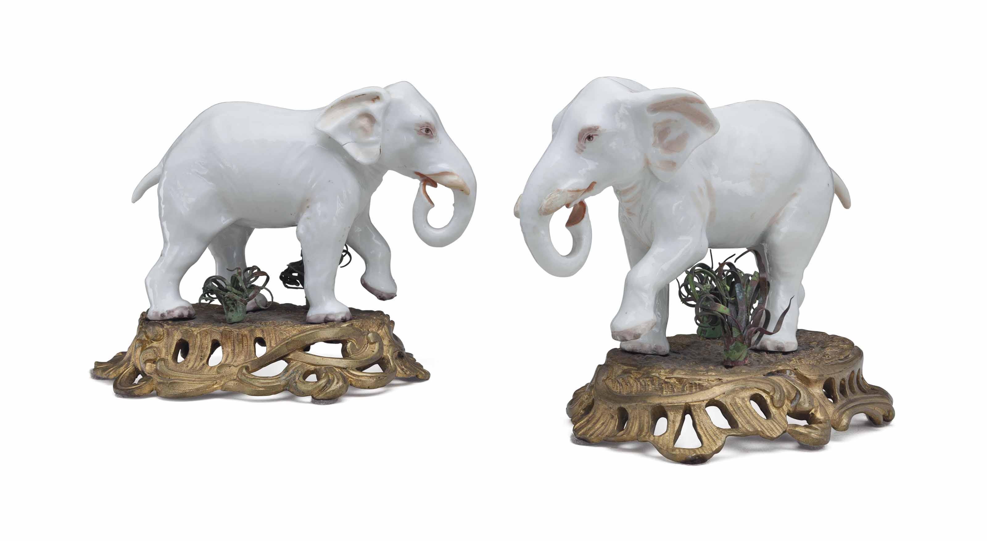 A PAIR OF ORMOLU AND TOLE-MOUNTED SAMSON PORCELAIN MODELS OF ELEPHANTS