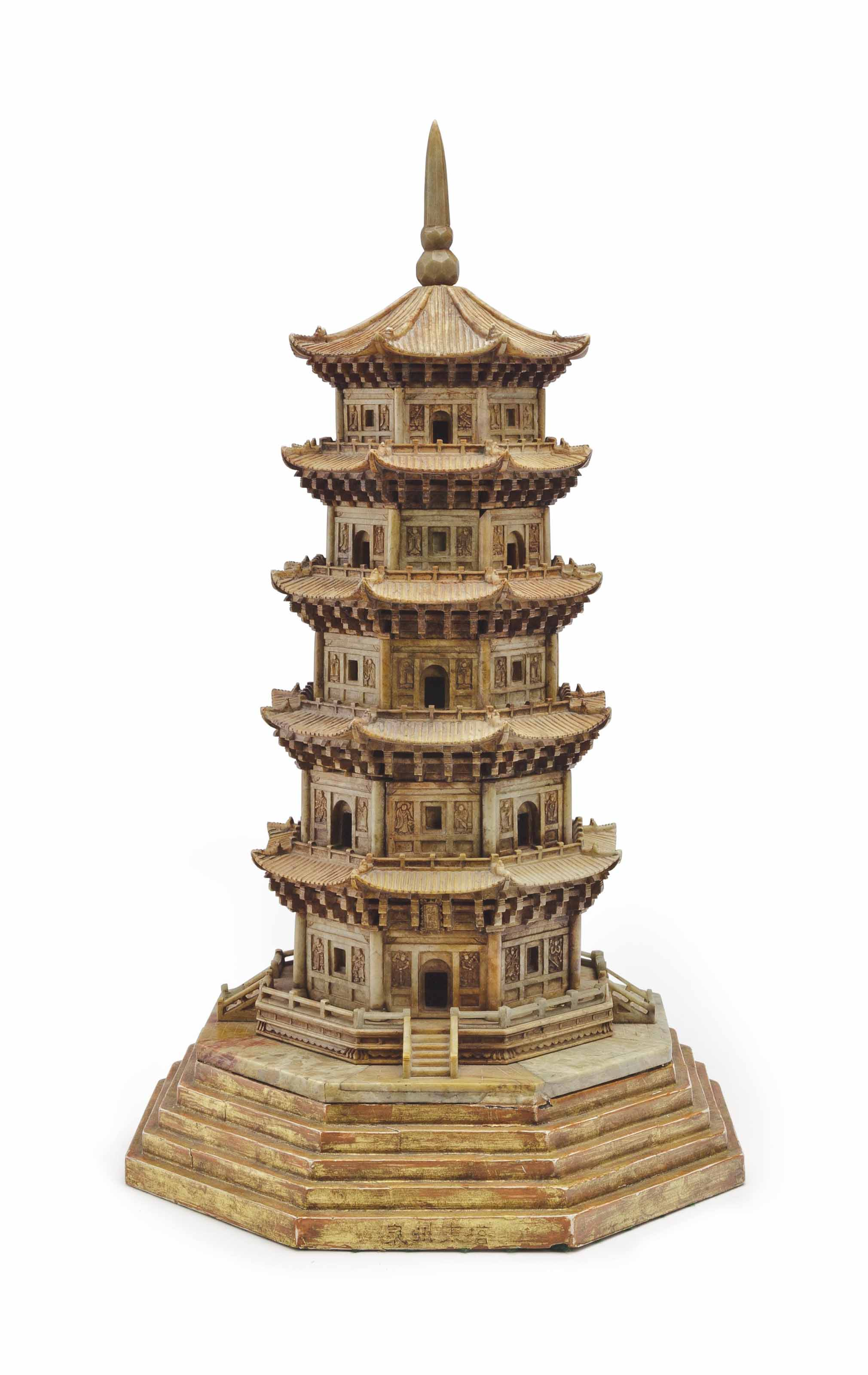 A CHINESE CARVED SOAPSTONE MODEL OF A PAGODA