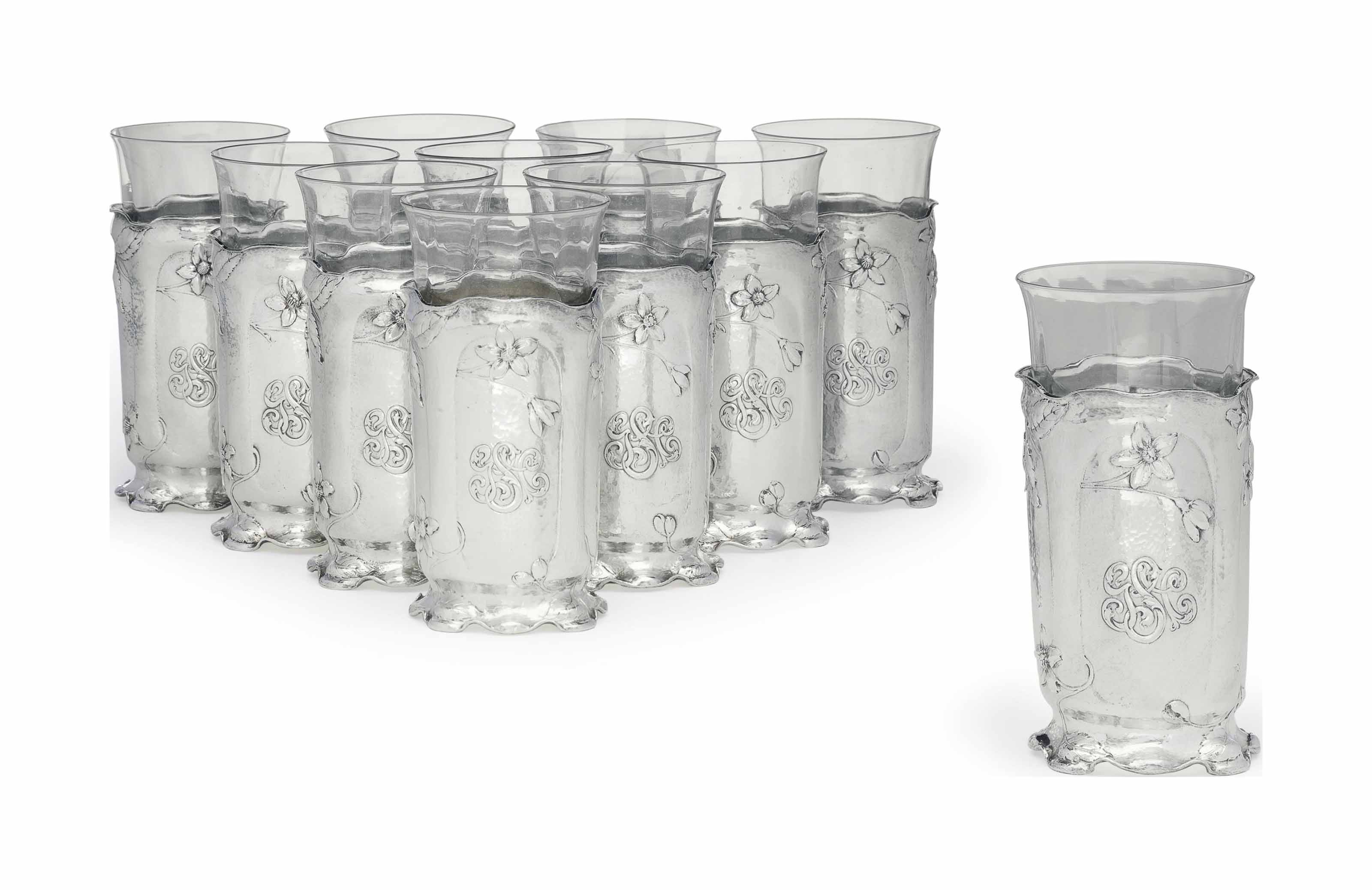 A SET OF ELEVEN AMERICAN MARTELE SILVER GLASSES