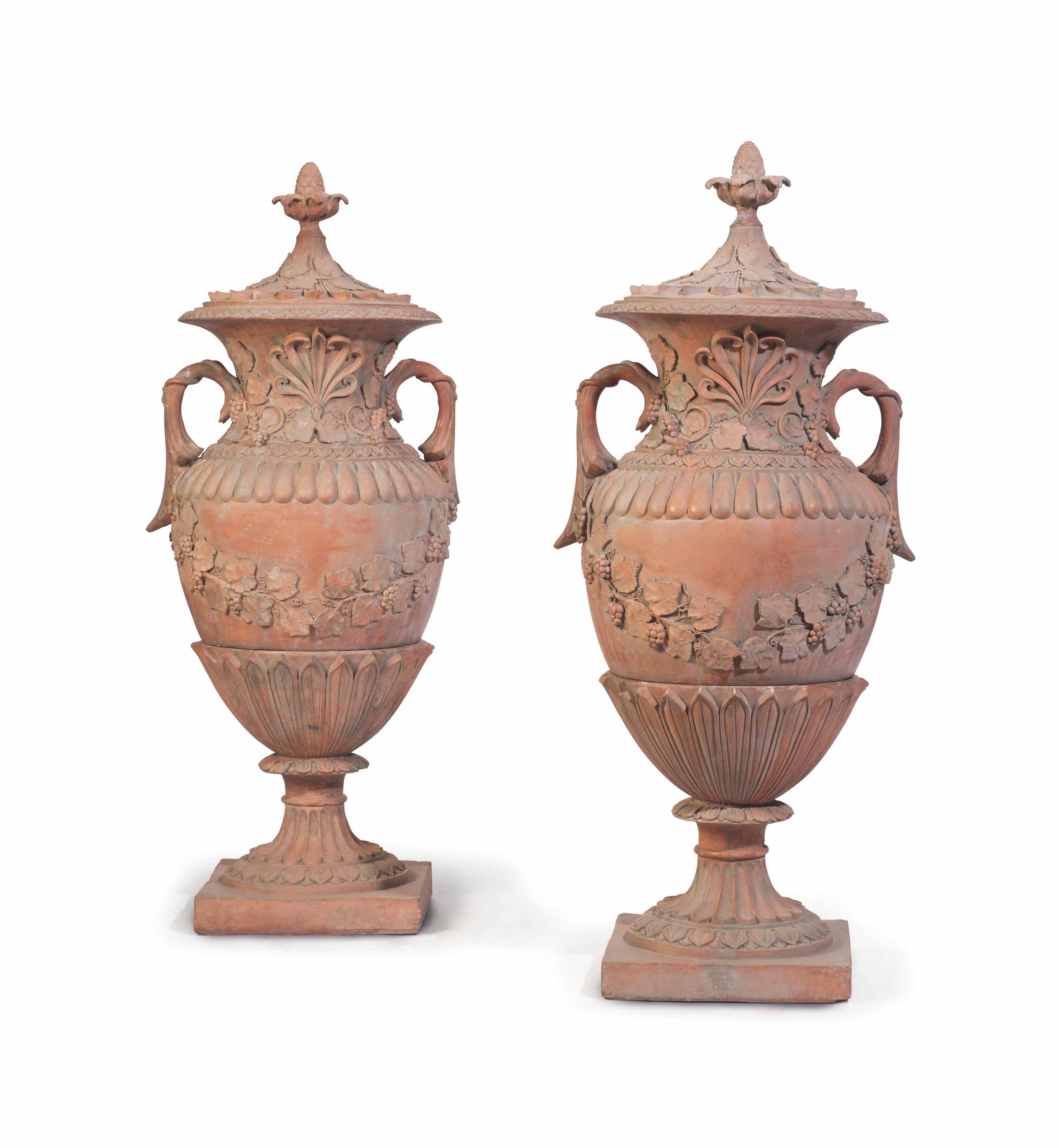 A PAIR OF TERRACOTTA VASES AND