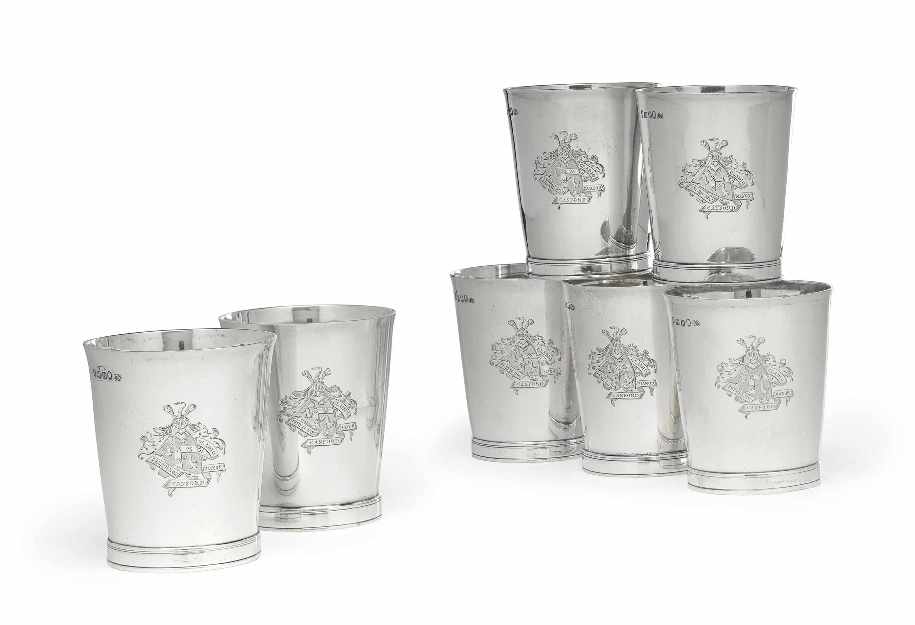 A SET OF SEVEN SILVER TUMBLERS