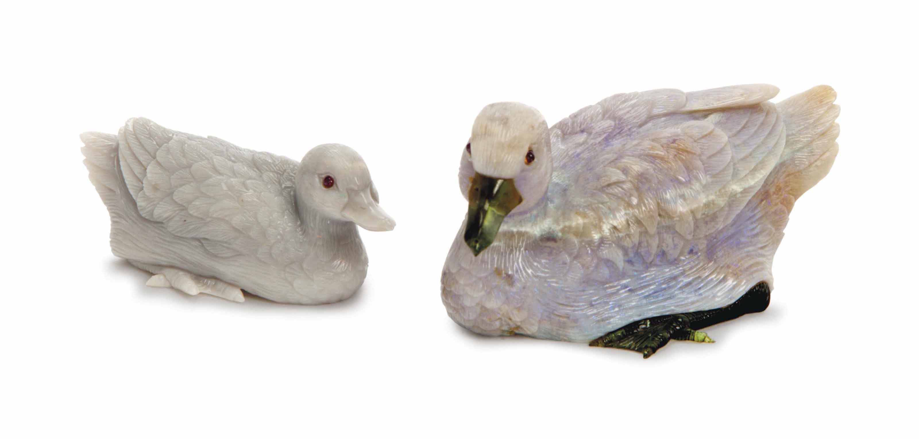 TWO CARVED OPAL DUCKS