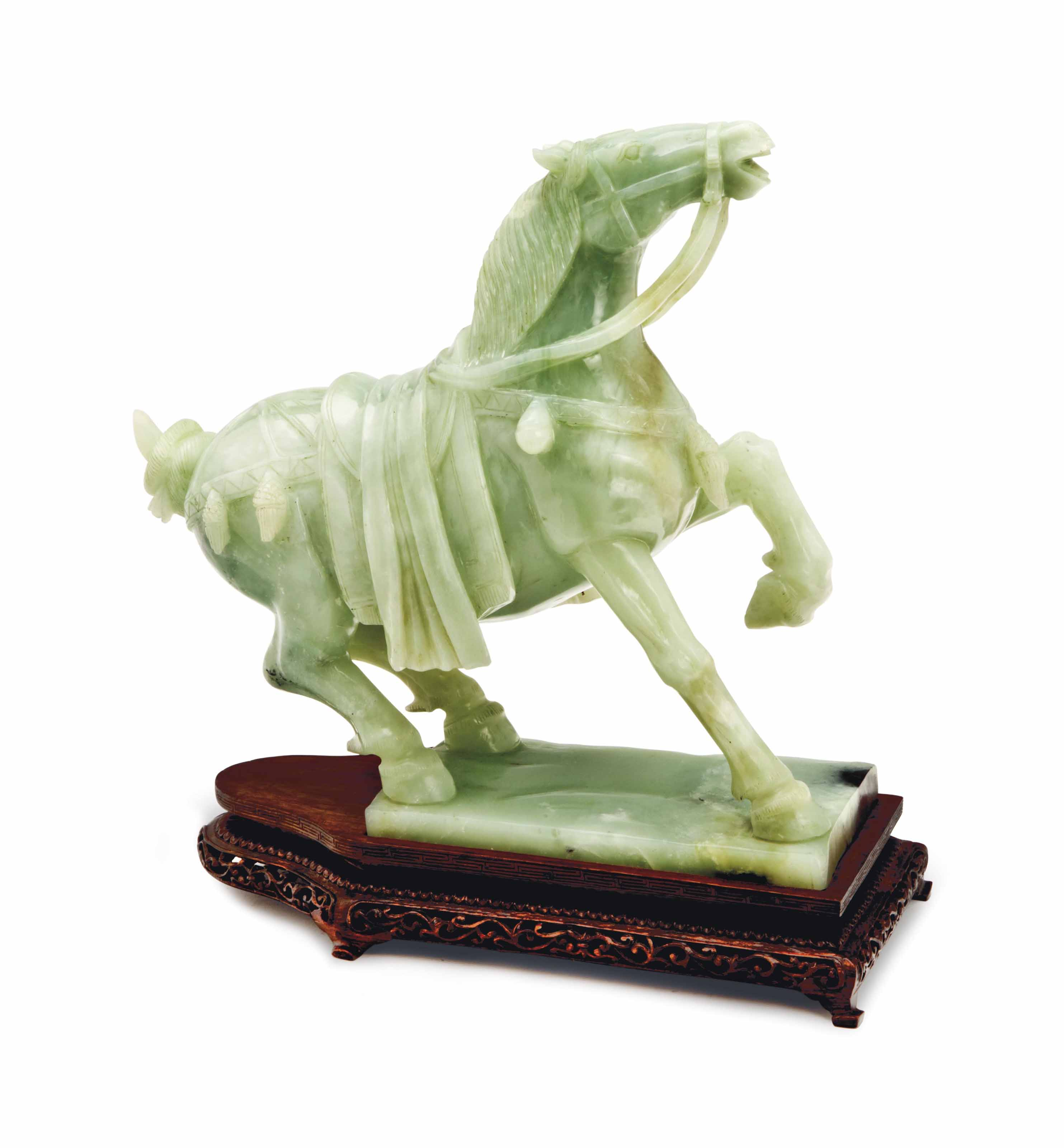 A CHINESE CARVED PALE GREEN JA