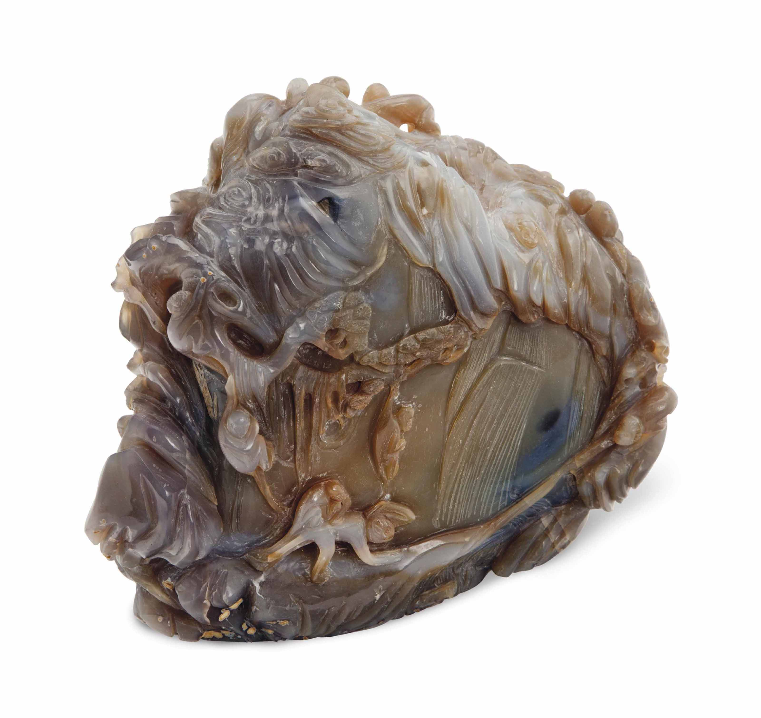 A CHINESE CARVED AGATE MONKEY