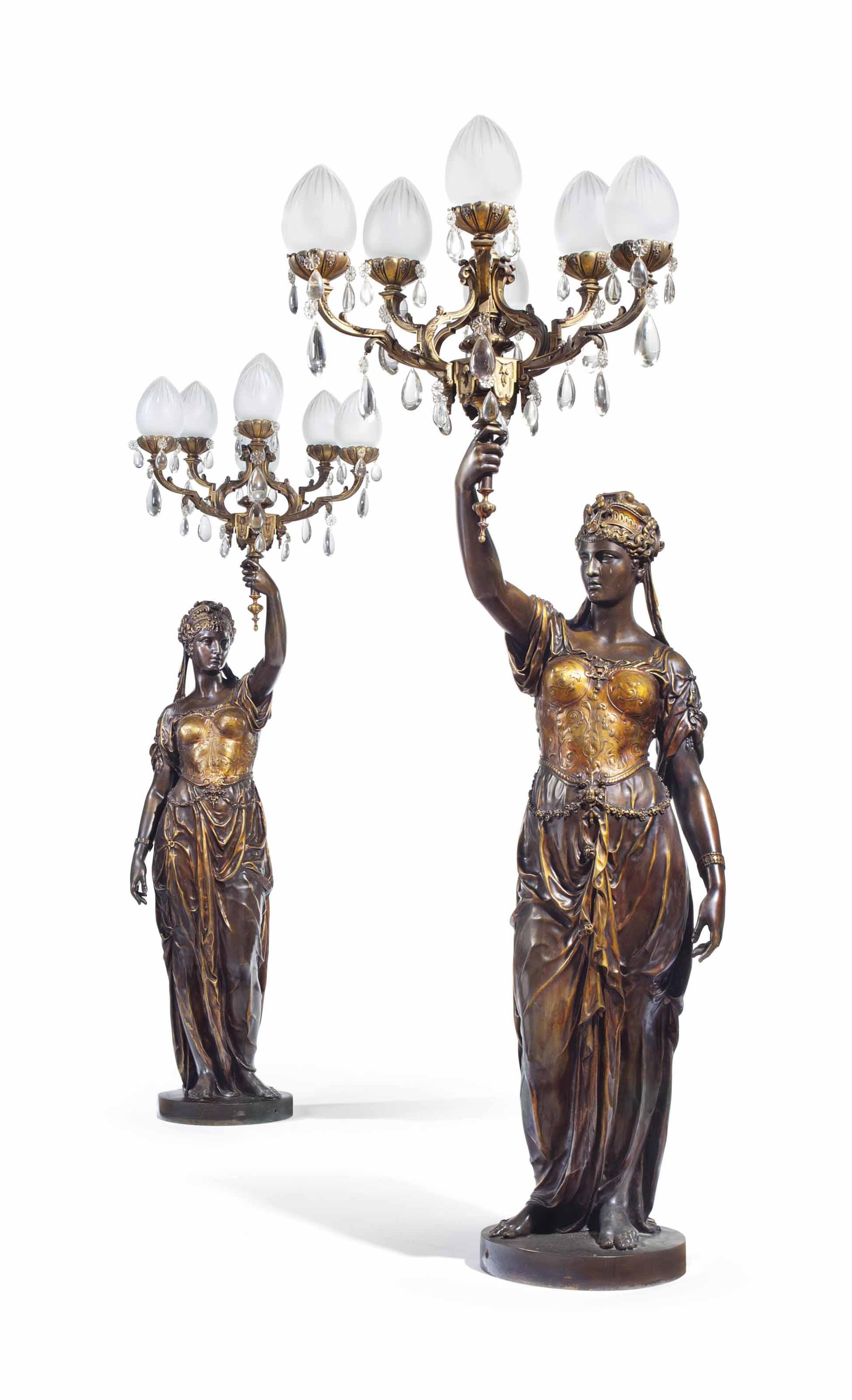 A PAIR OF LARGE FRENCH PARCEL-GILT AND PATINATED BRONZE FIGURAL SEVEN-LIGHT TORCHERES, TITLED 'DEUX FEMMES DE LA RENAISSANCE'