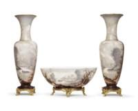 AN ORMOLU-MOUNTED BACCARAT OPAQUE GLASS THREE-PIECE GARNITURE