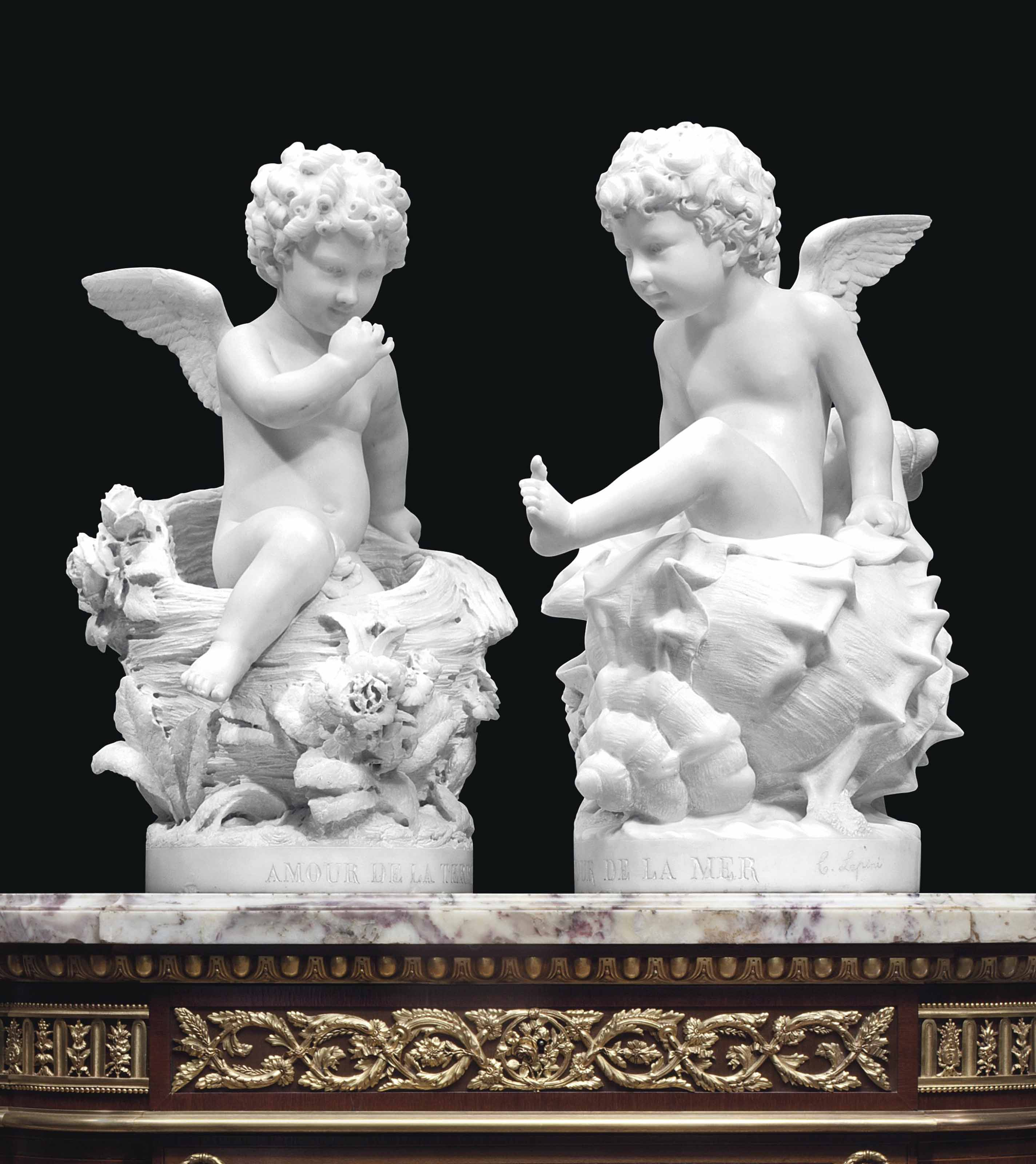 A PAIR OF ITALIAN WHITE MARBLE FIGURES OF PUTTI TITLED 'AMOUR DE LA MER' AND 'AMOUR DE LA TERRE'