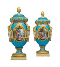 A PAIR OF MINTON PORCELAIN SEVRES STYLE TURQUOISE-GROUND VASES AND COVERS