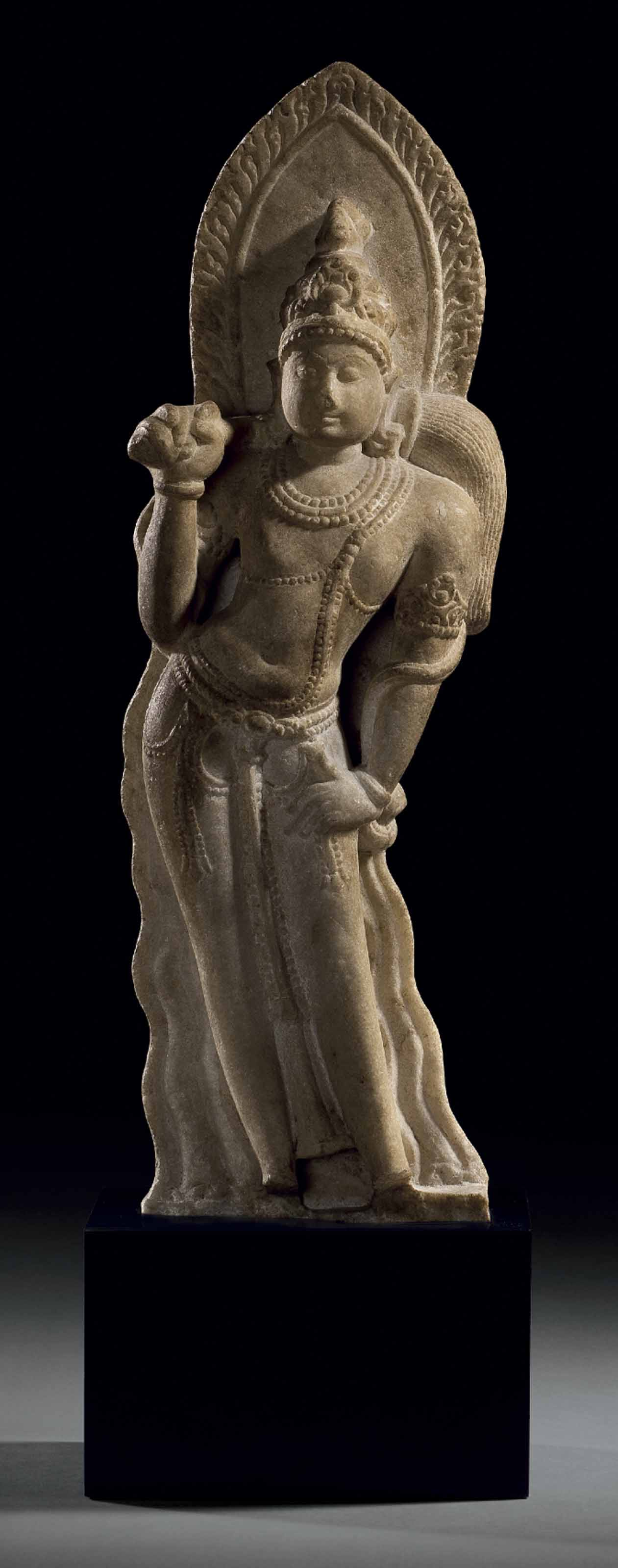 A MARBLE FIGURE OF AN ATTENDAN