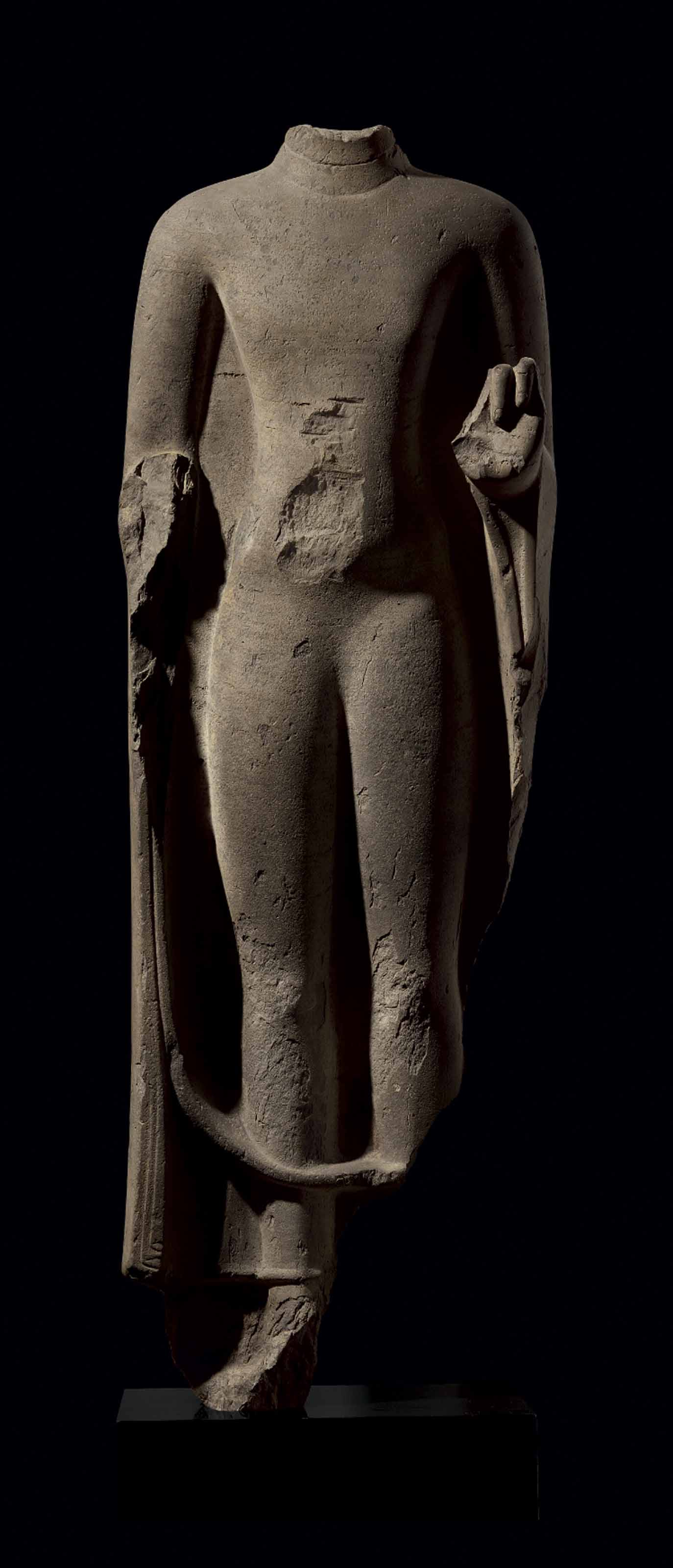 AN IMPORTANT STONE FIGURE OF B