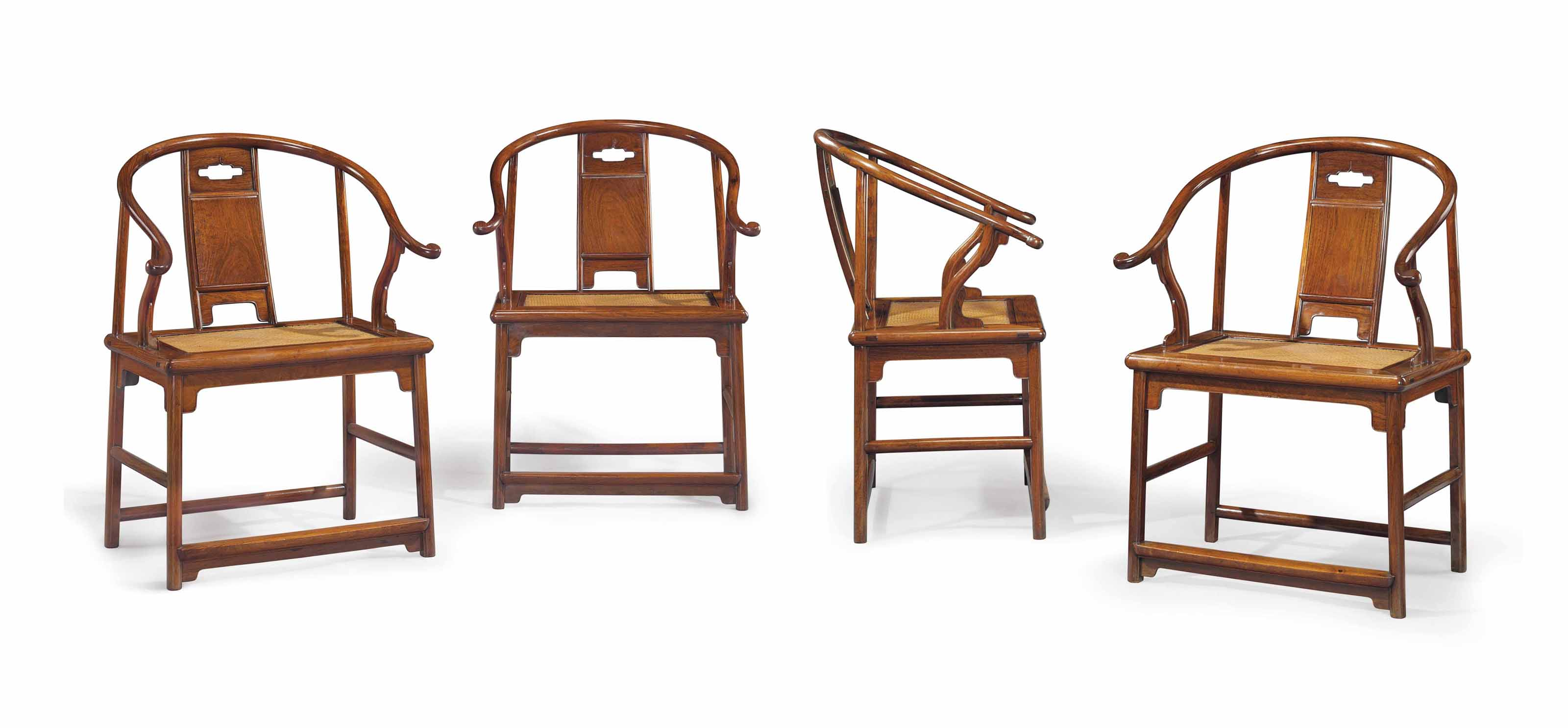 AN EXTREMELY RARE AND IMPORTANT SET OF FOUR HUANGHUALI HORSESHOE-BACK ARMCHAIRS, QUANYI