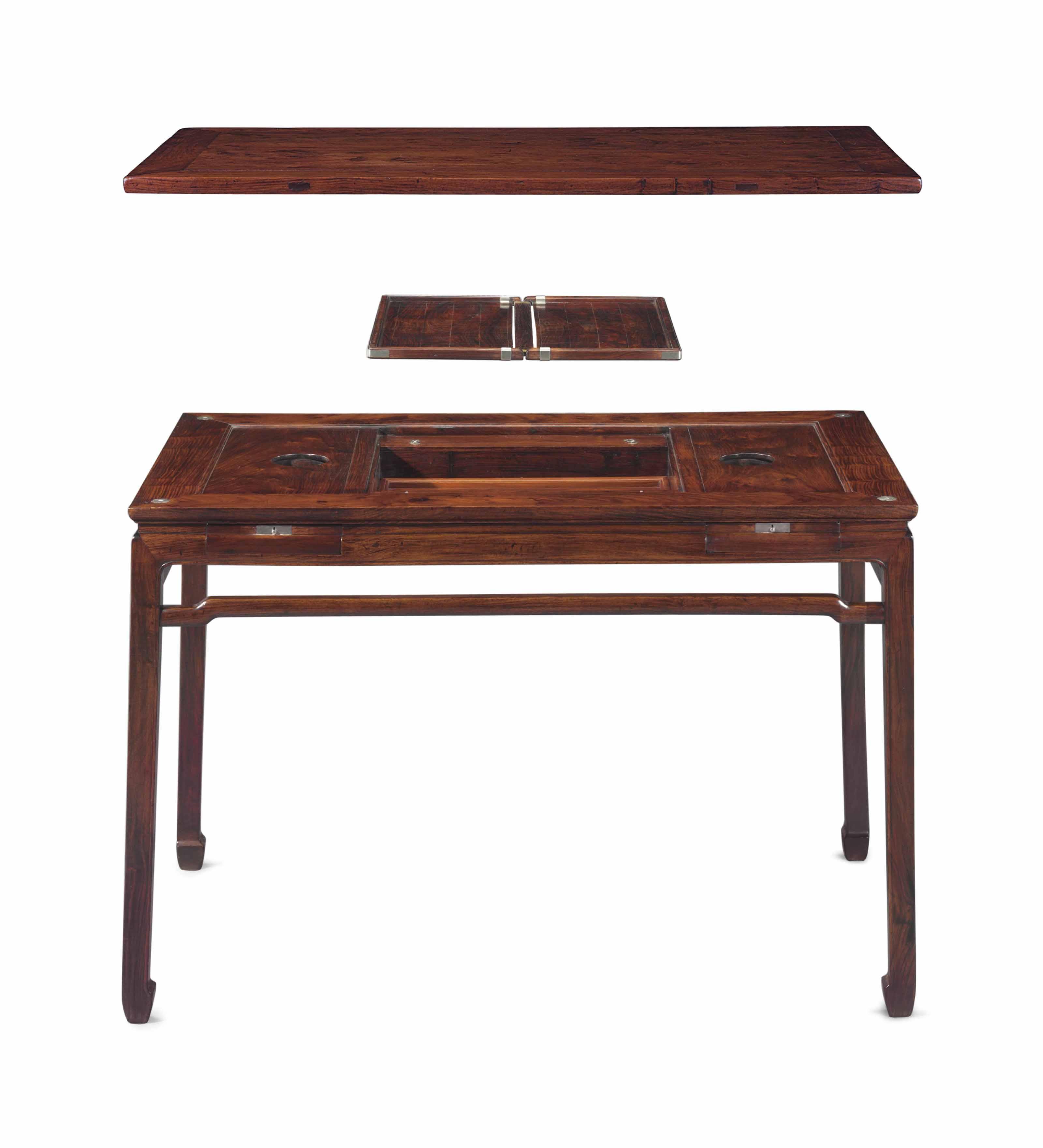 A VERY RARE HUANGHUALI WAISTED RECTANGULAR CORNER-LEG GAMES TABLE