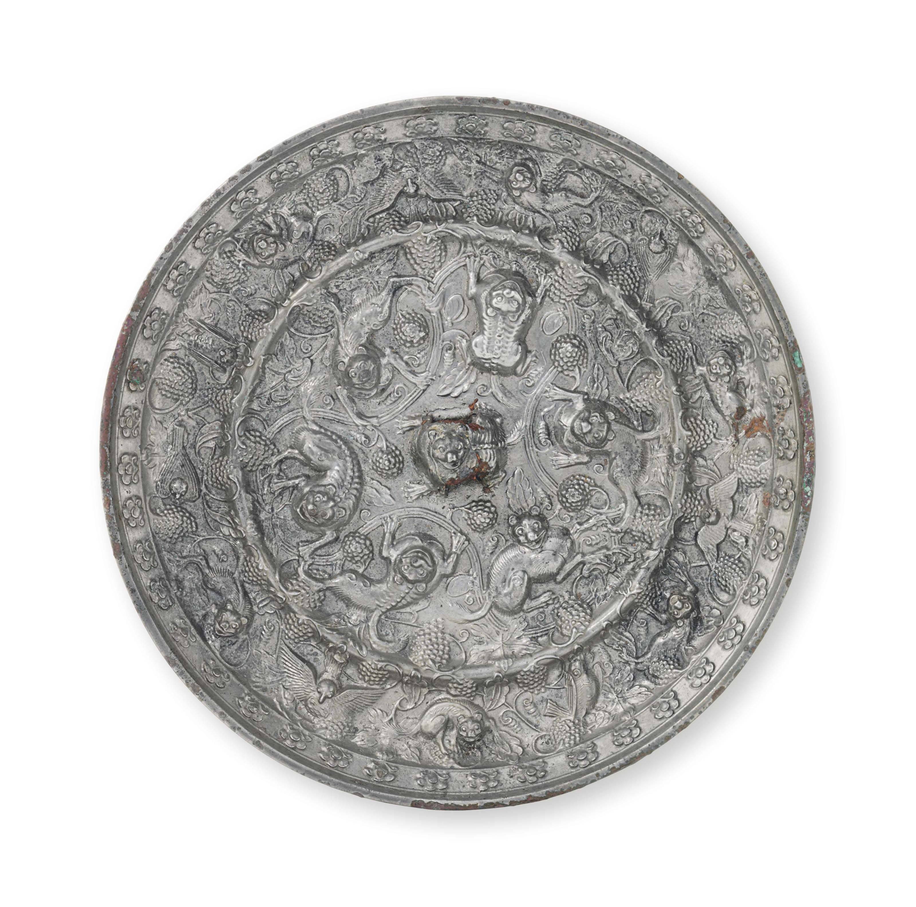 Image result for A large silvery bronze 'Lion and grapevine' circular mirror, China, Tang dynasty (AD 618-907)