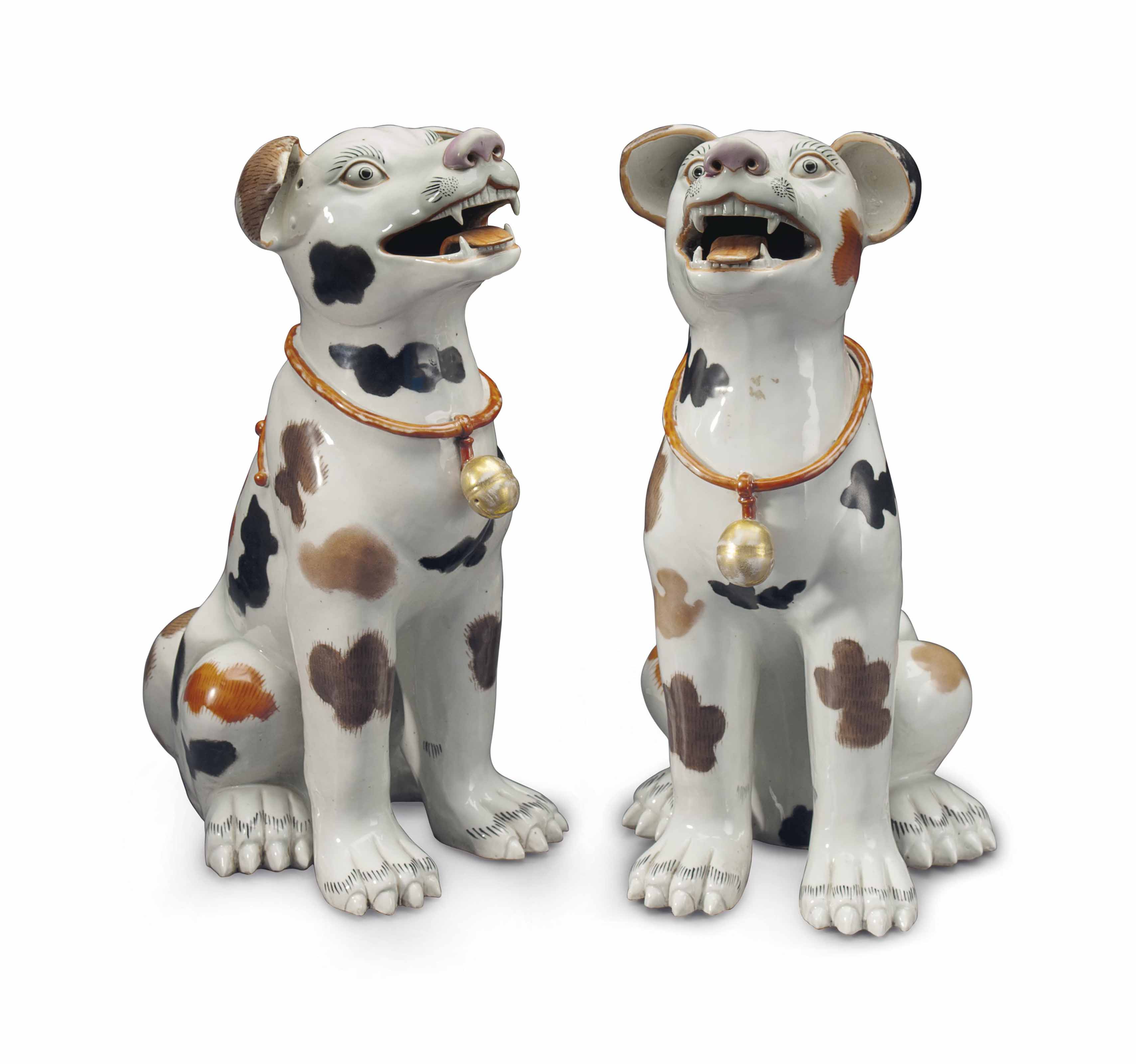 A LARGE PAIR OF ARITA STYLE PORCELAIN HOUNDS