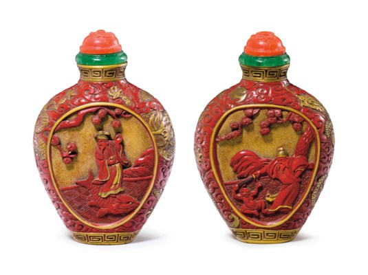 A CARVED RED AND GOLD LACQUER