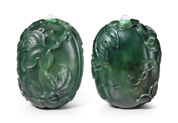 A WELL-CARVED SPINACH-GREEN JA