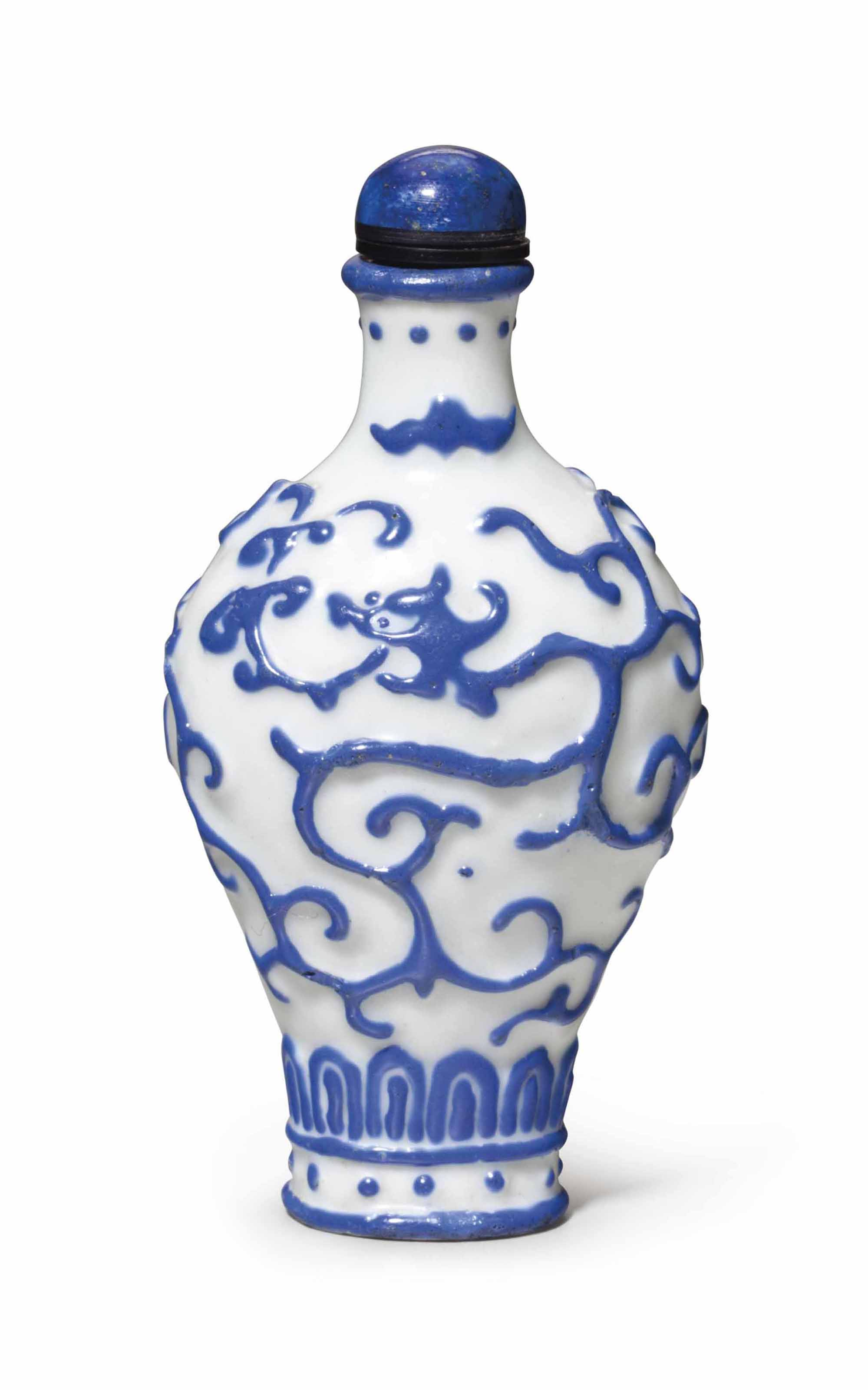 A BLUE AND WHITE-ENAMELED MOLD