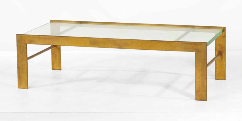 Marc du Plantier (1901-1975), Low table, 1934. Gold-patinated steel and the original glass. 40 x 140 x 62 cm (15¾ x 55⅛ x 24⅜ in). Sold for €181,500 on 19 May 2015 at Christie's in Paris