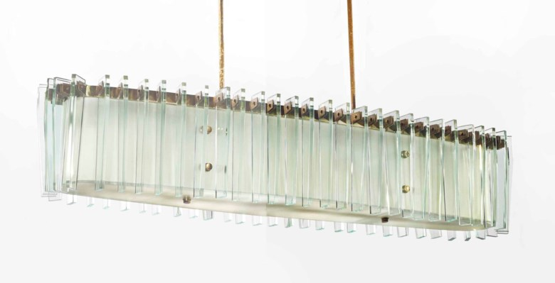 Fontana Arte, A glass and brass ceiling light, circa 1950. Height 80  cm; length 120  cm; width 30  cm. Sold for €47,100 on 19 May 2015 at Christie's in Paris
