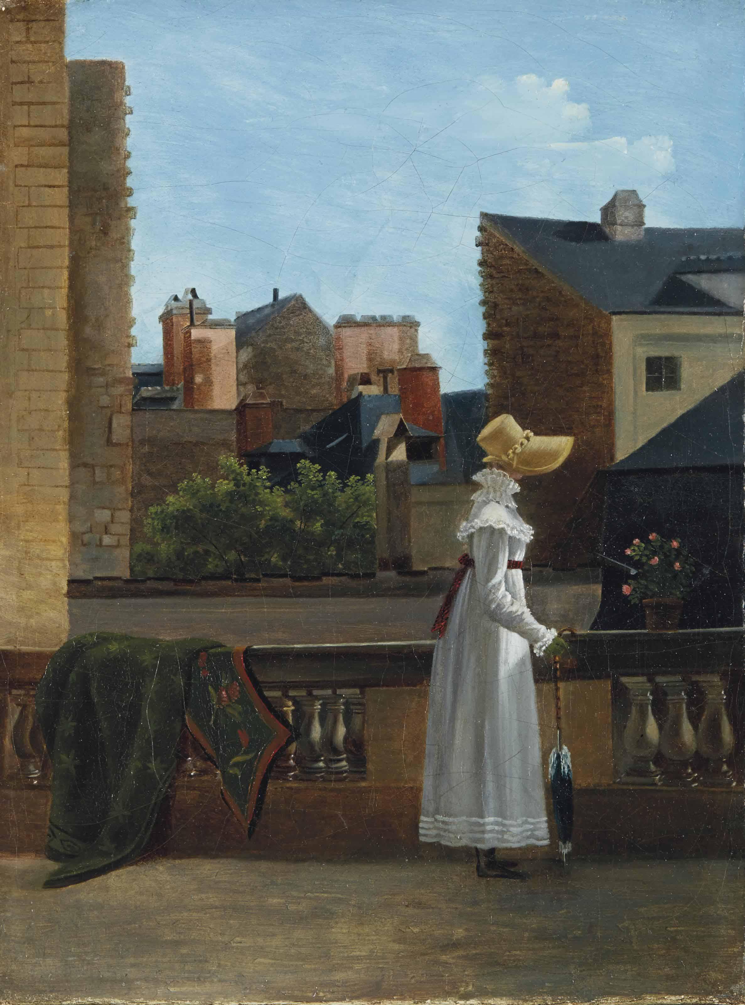 Elégante sur une terrasse avec une vue de ville en arrière-plan