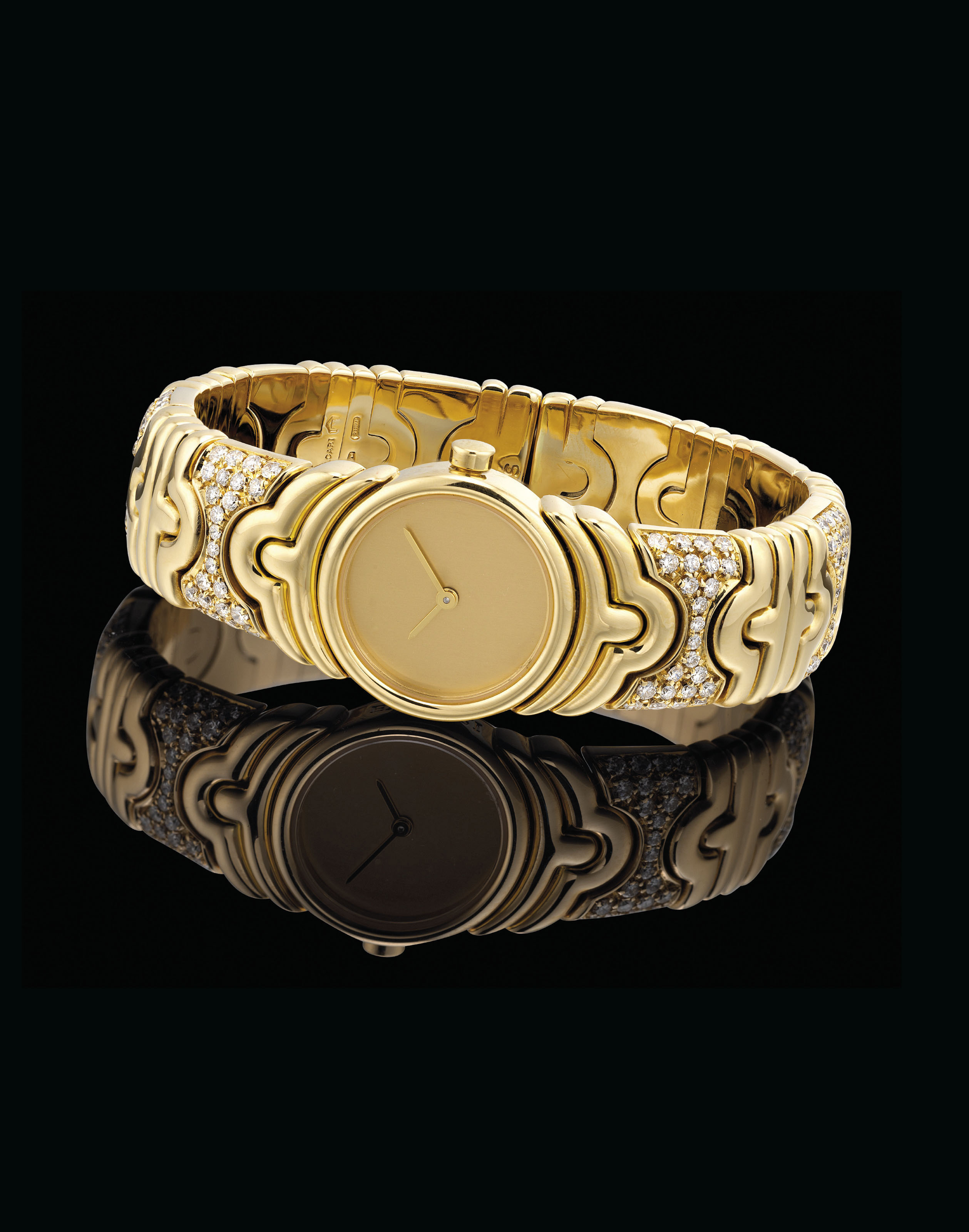 BULGARI. A LADY'S 18K GOLD AND